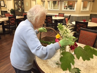 Mom arranging bouquet The Arbors June 2017