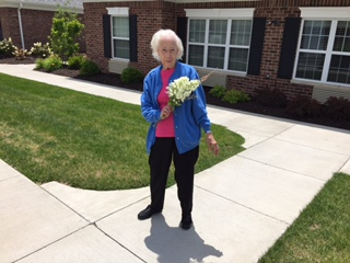 Mom gathering flowers for bouquet June 2017